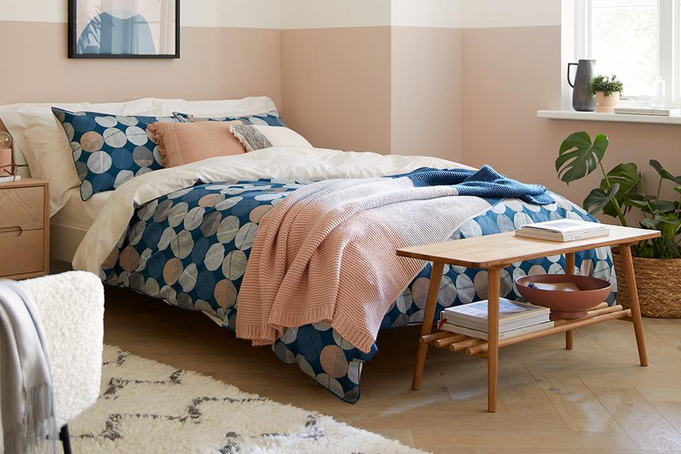 Blue and pink polka dot bedding.