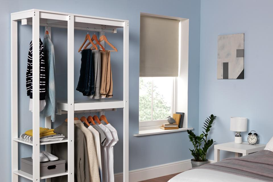 Open wardrobe with different clothes and accessories.