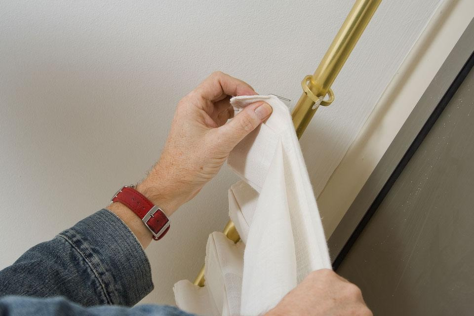 How to put up a curtain pole.