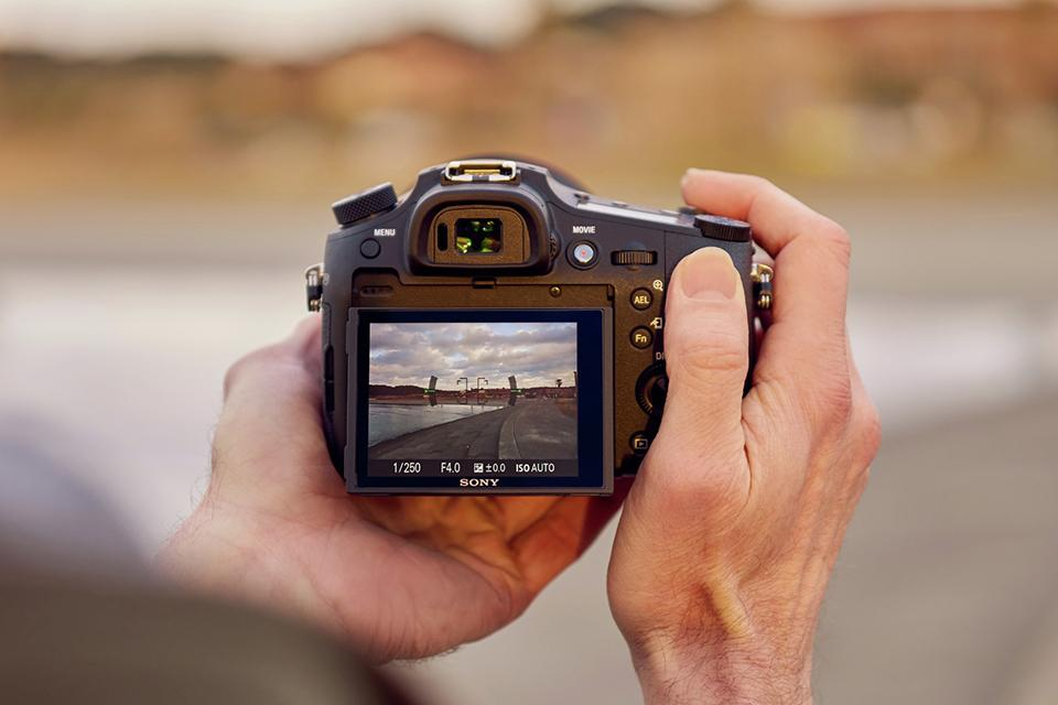 A digital camera is shown close up as it captures a photo through live view.