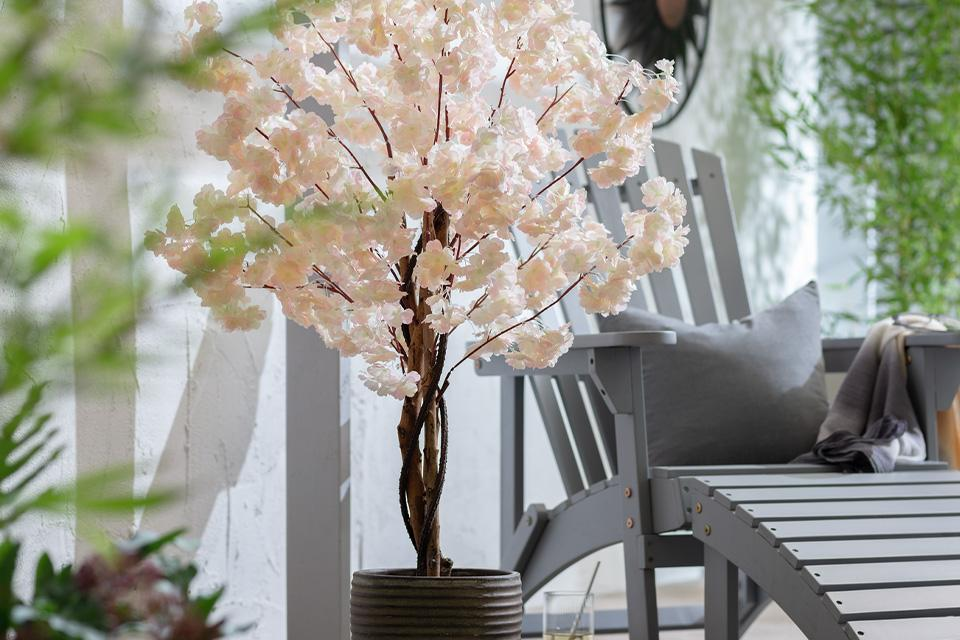 Faux cherry blossom tree in garden.
