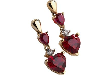 Cut out image of a pair of gold, ruby and diamond accent heart drop earrings.