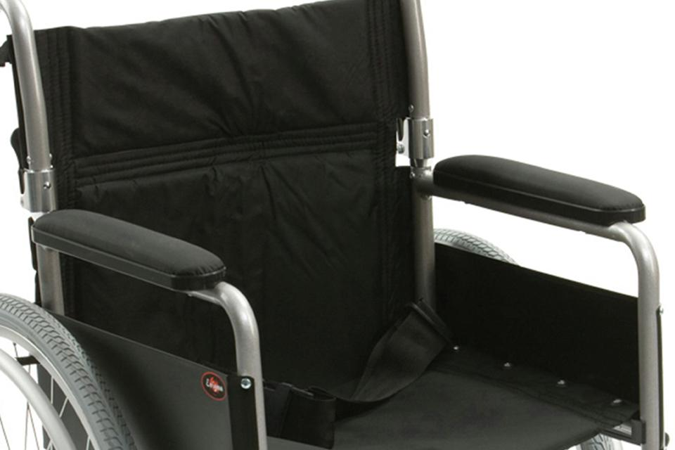 Close up of wheelchair with padded armrests.
