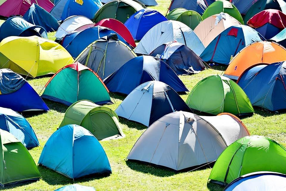Tents in a field.