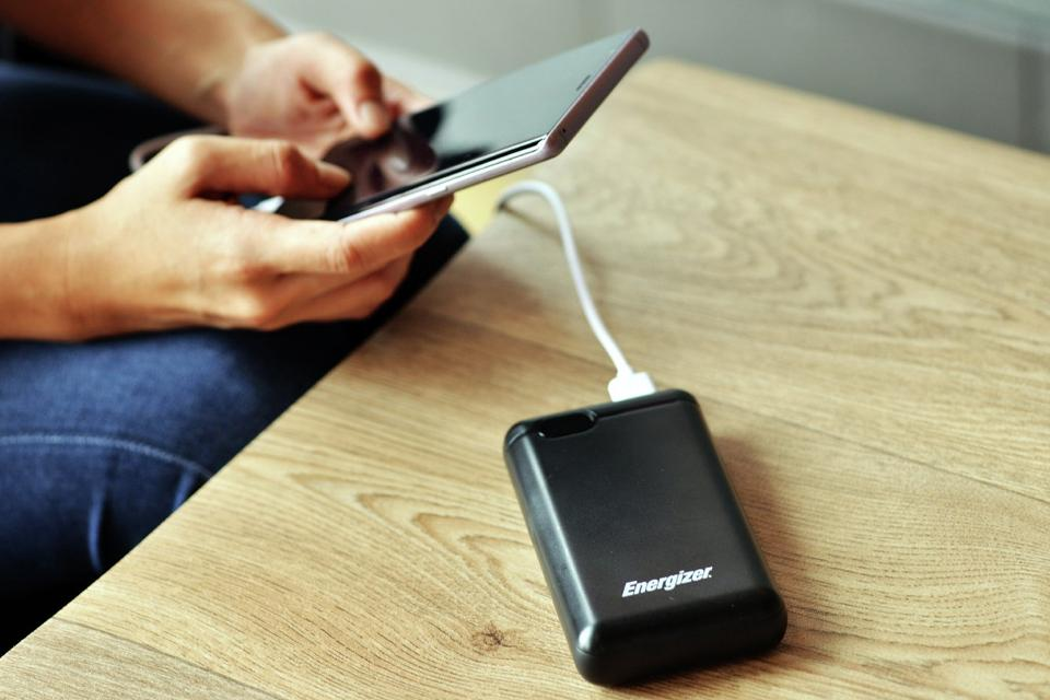 Portable power on table charging phone.