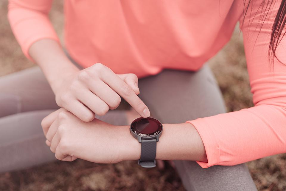 Person using smart watch.
