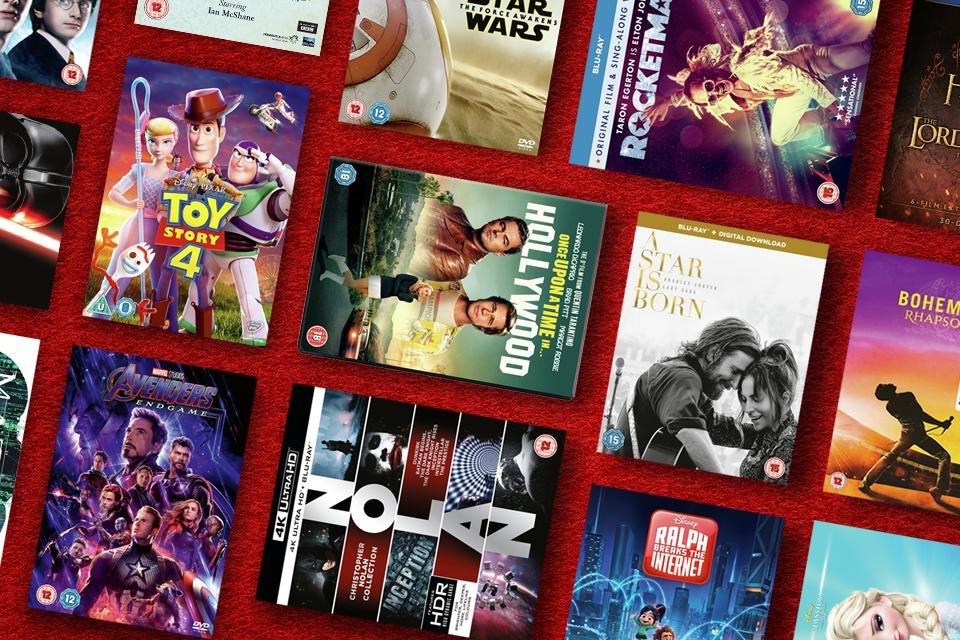 A variety of DVDs displayed with a red background.
