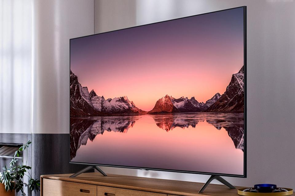 A 55 inch television with a QLED display.