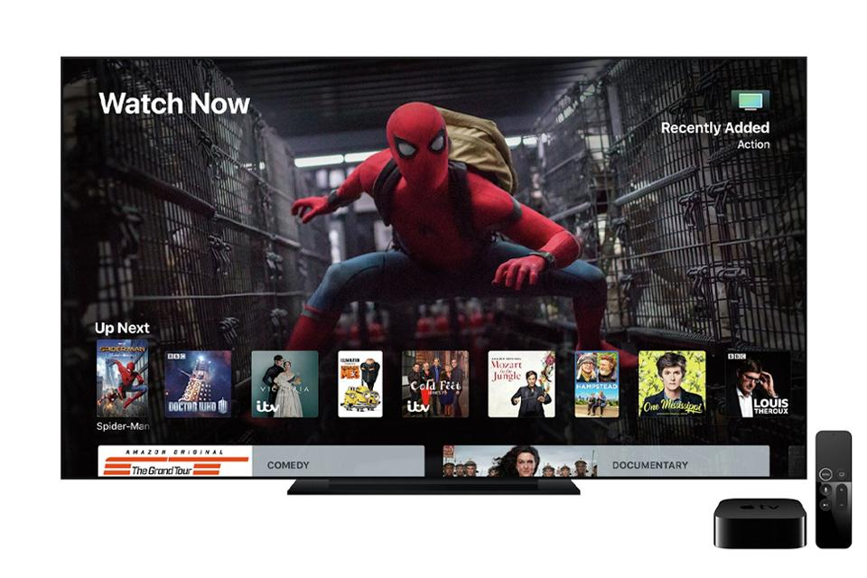 A television showing a movie with an Apple TV box and Siri remote.