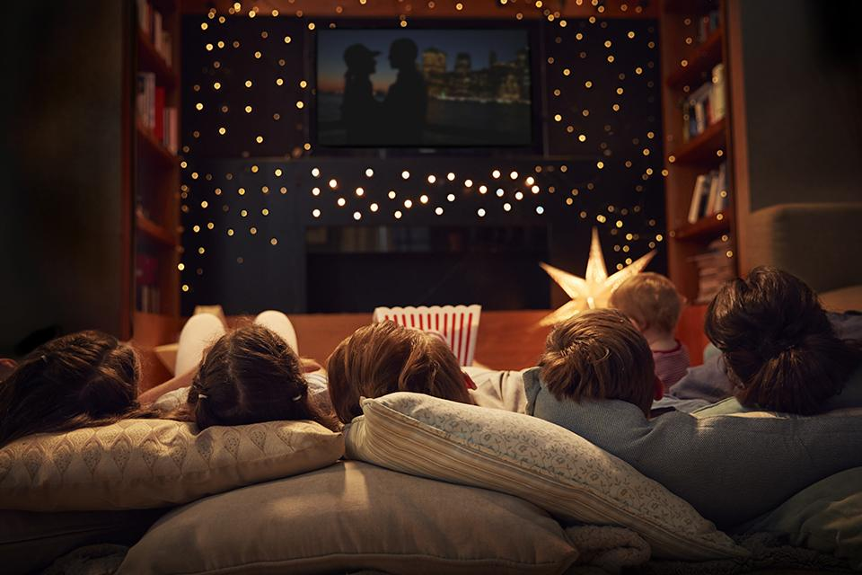 Family enjoying movie night at home together.