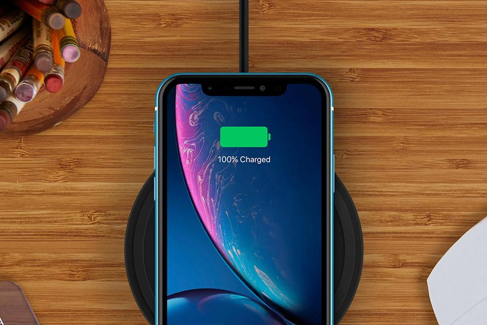 Close-up phone charging on wireless charger device.