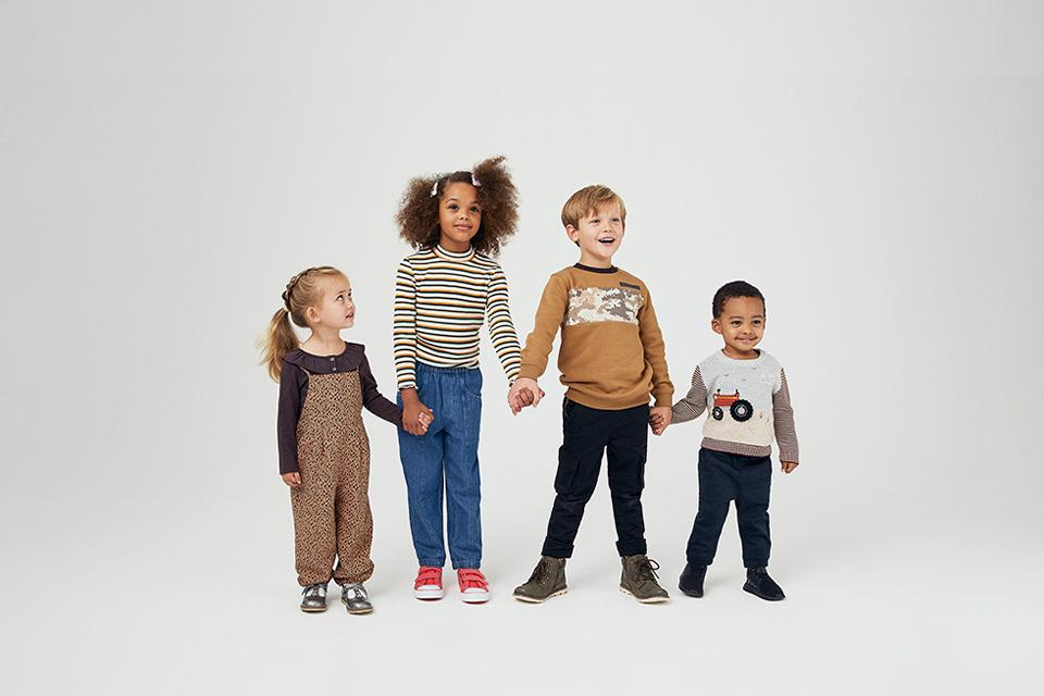 Up to 1/2 price kids clothing sale.
