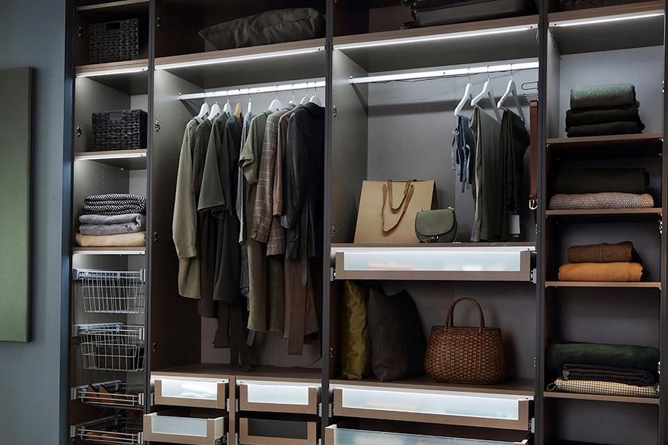 Neatly organised fitted wardrobe, with rails, drawers and shelves to neatly store all your clothes and shoes.