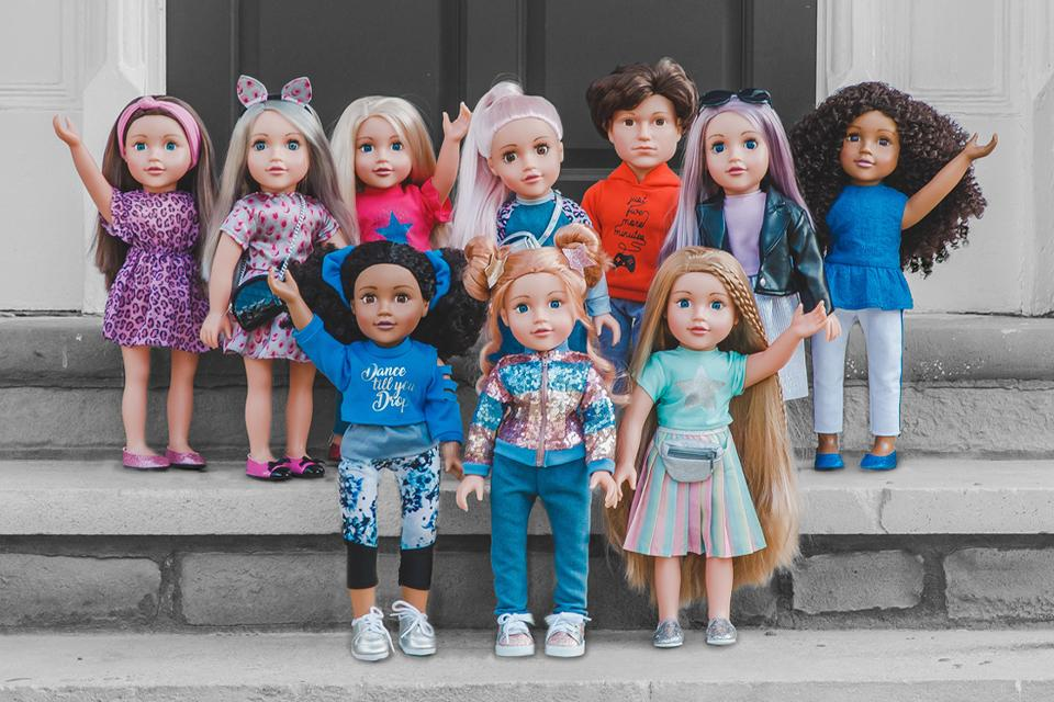 All ten DesignaFriend dolls stood together outside on a stone step.