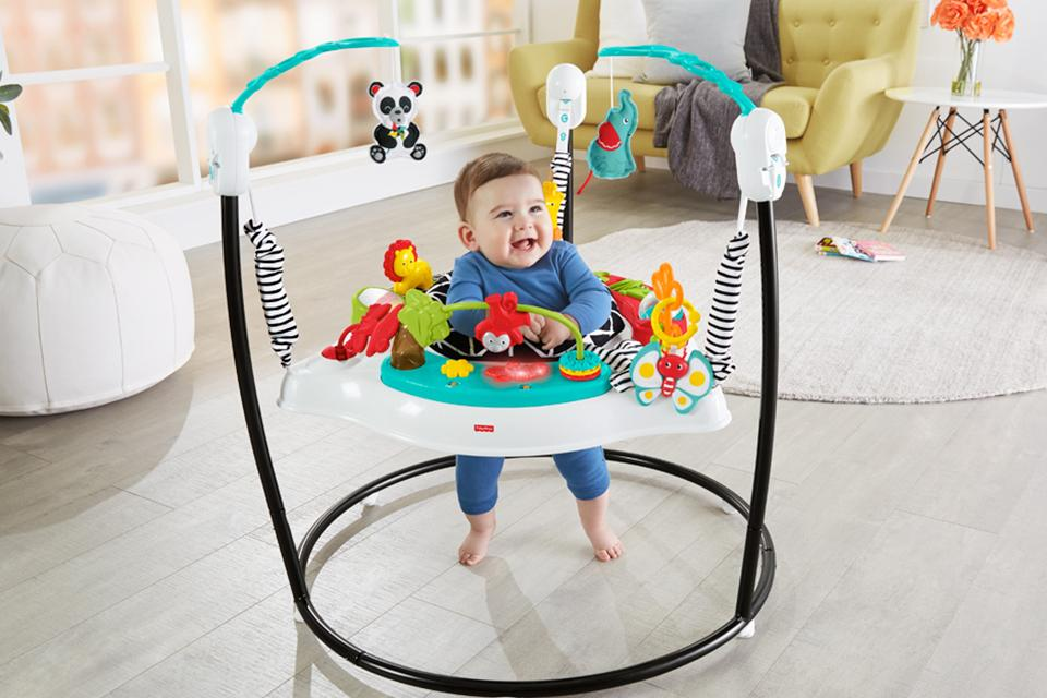 Baby in jumperoo with animals on.
