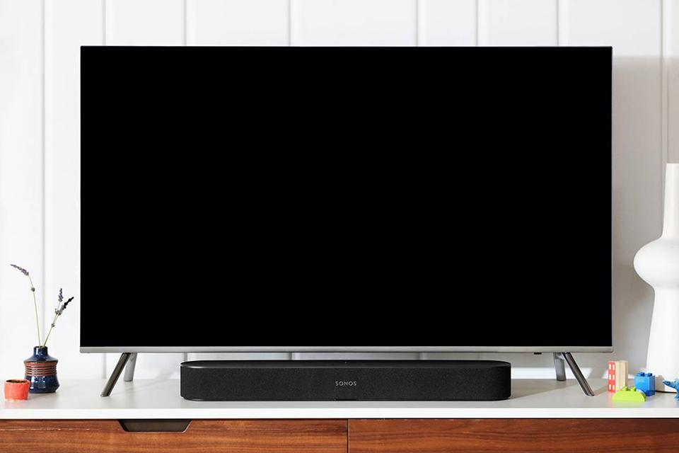 A television with a Sonos soundbar underneath it.