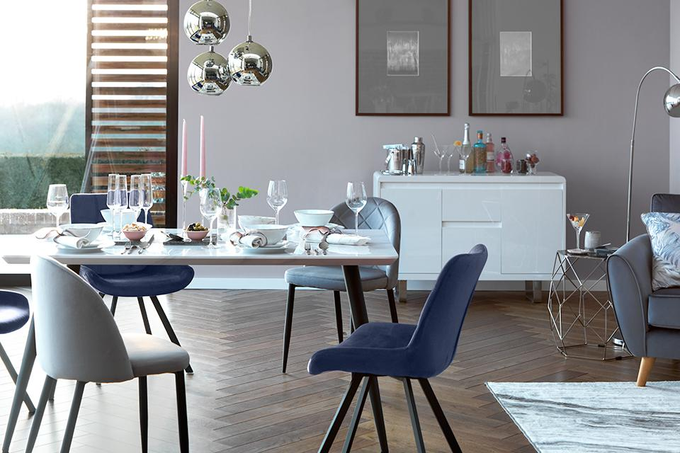 Dining table and velvet dining chairs.