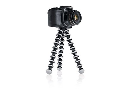 Cut out image of a Joby Tripod with a camera mounted to it.
