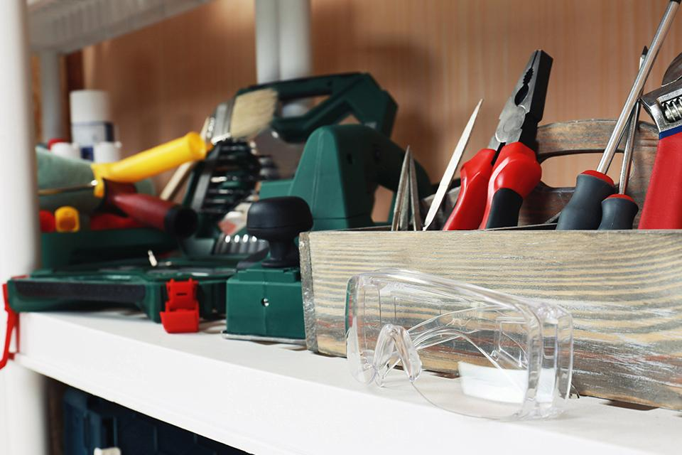 Selection of tools on shelf.
