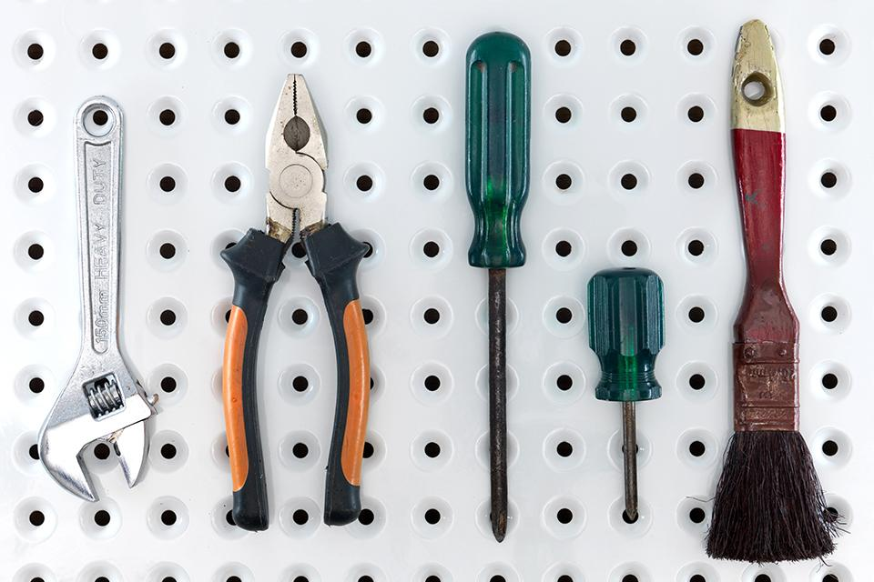 Tools hanging on a pegboard.