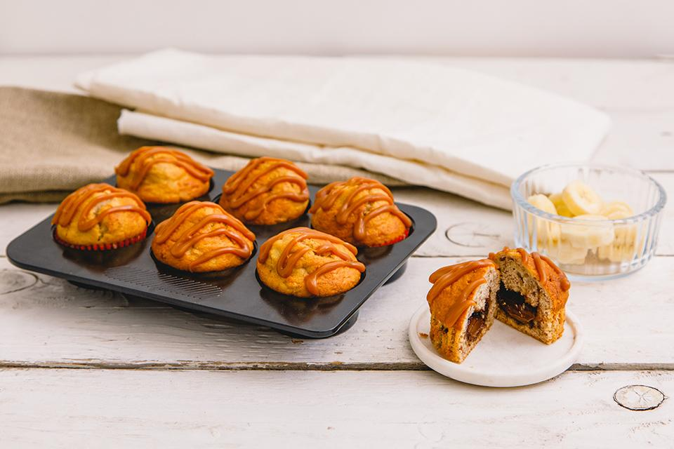 Freshly baked cakes in a cake tin.