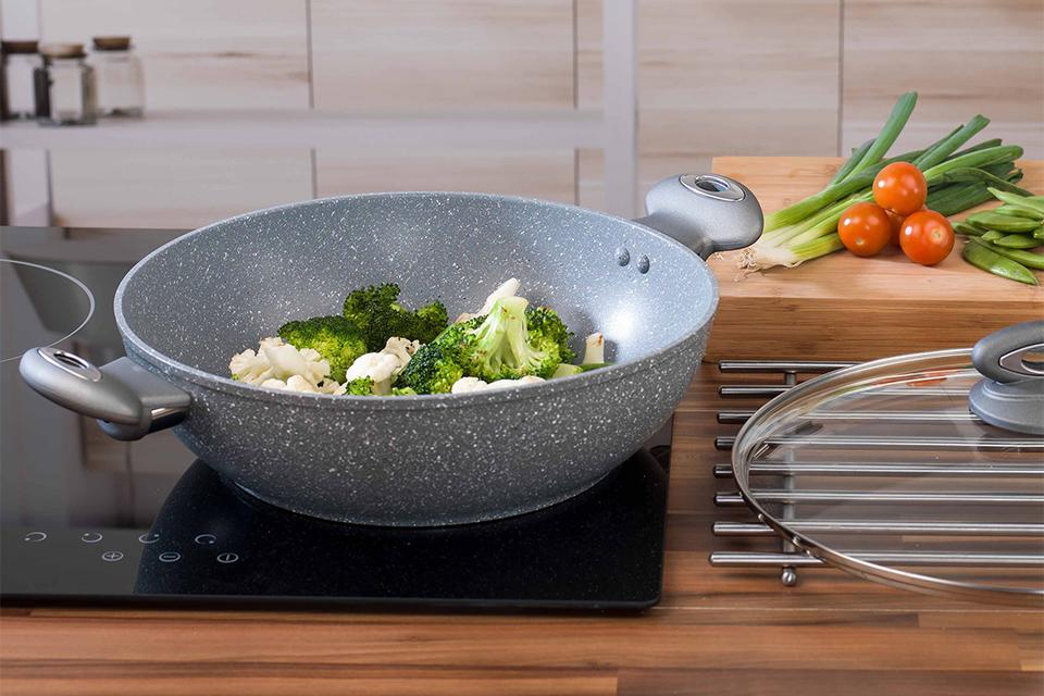 Vegetables cooking in a wok.