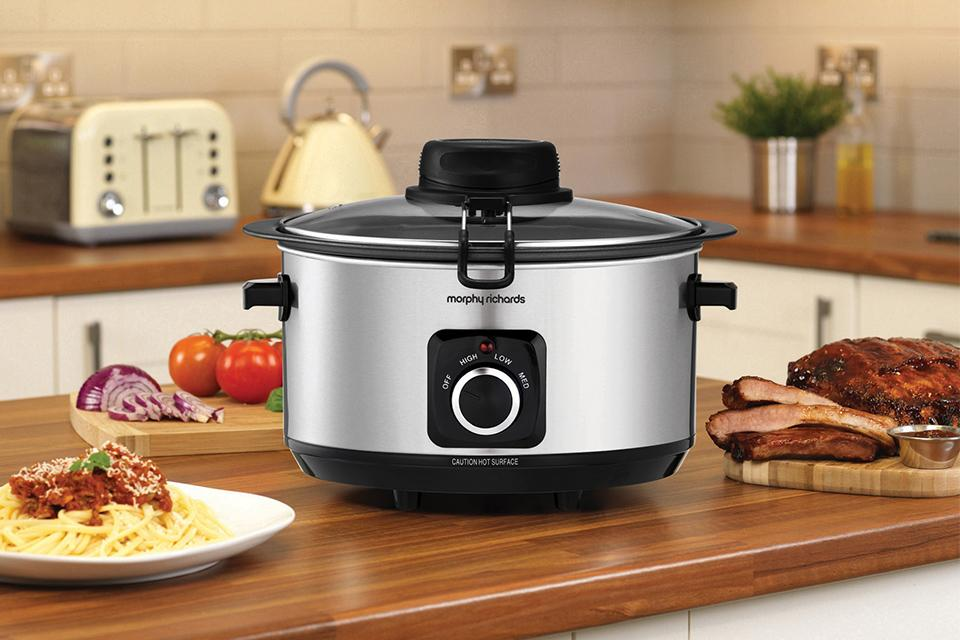 Slow cooker on kitchen side.