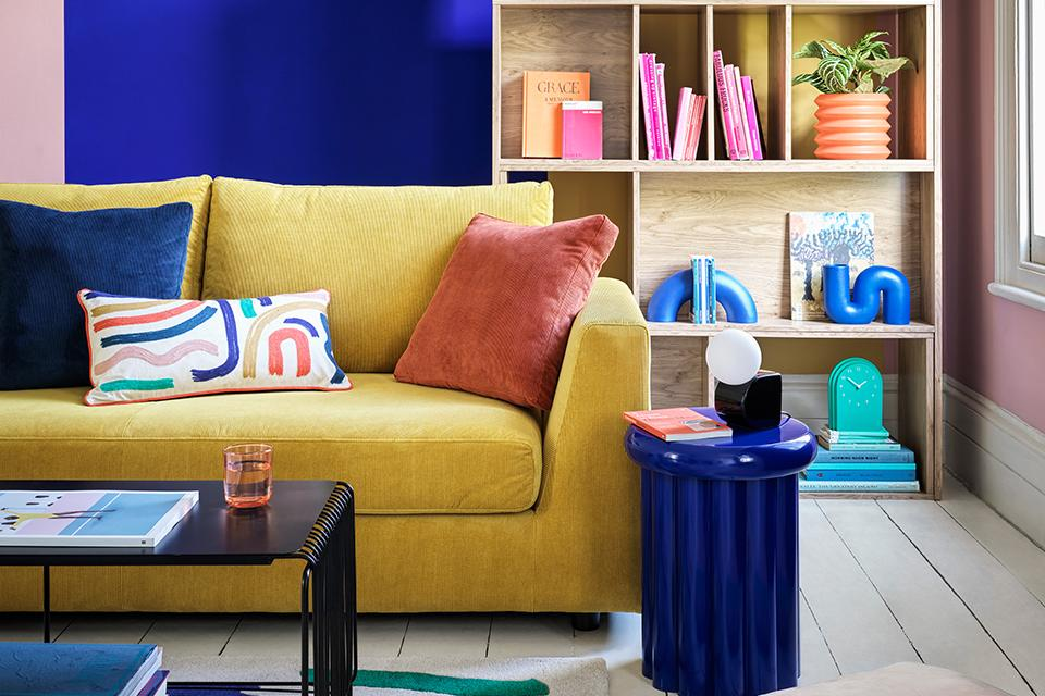 Image of a yellow sofa in a blue and pale pink living room.
