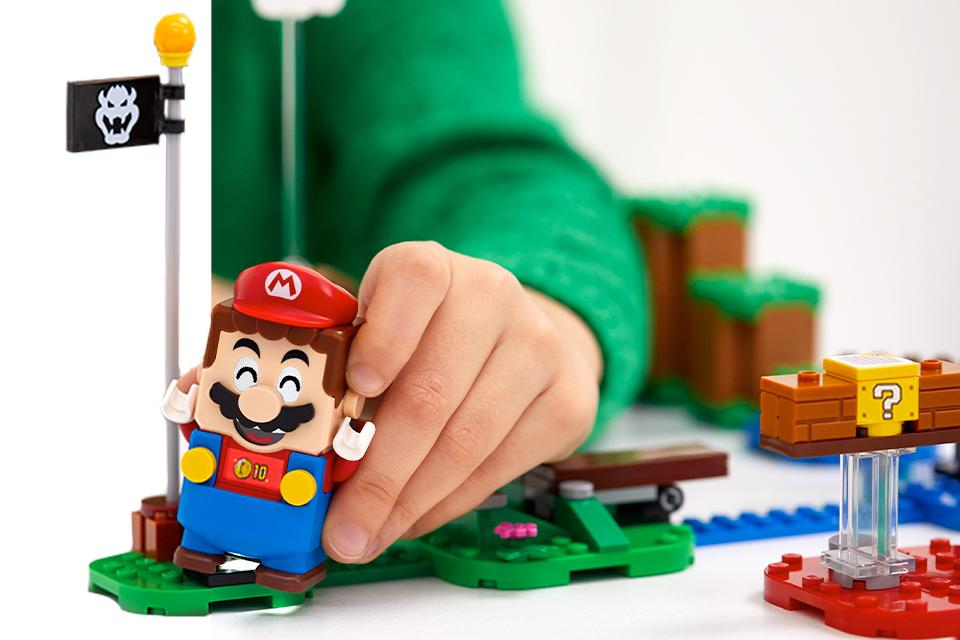 Mario toy being played with.