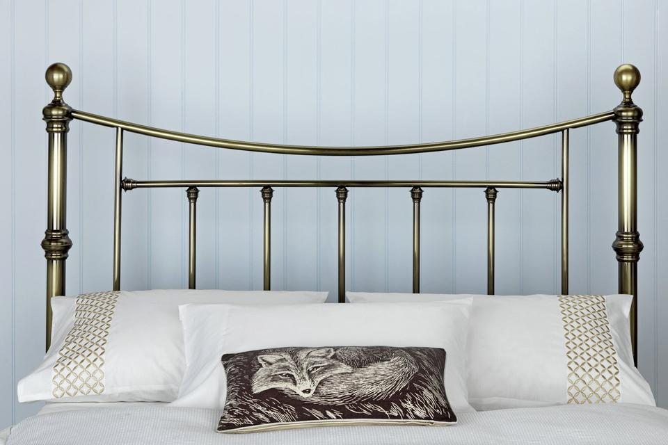 2. Make a statement with a metal headboard
