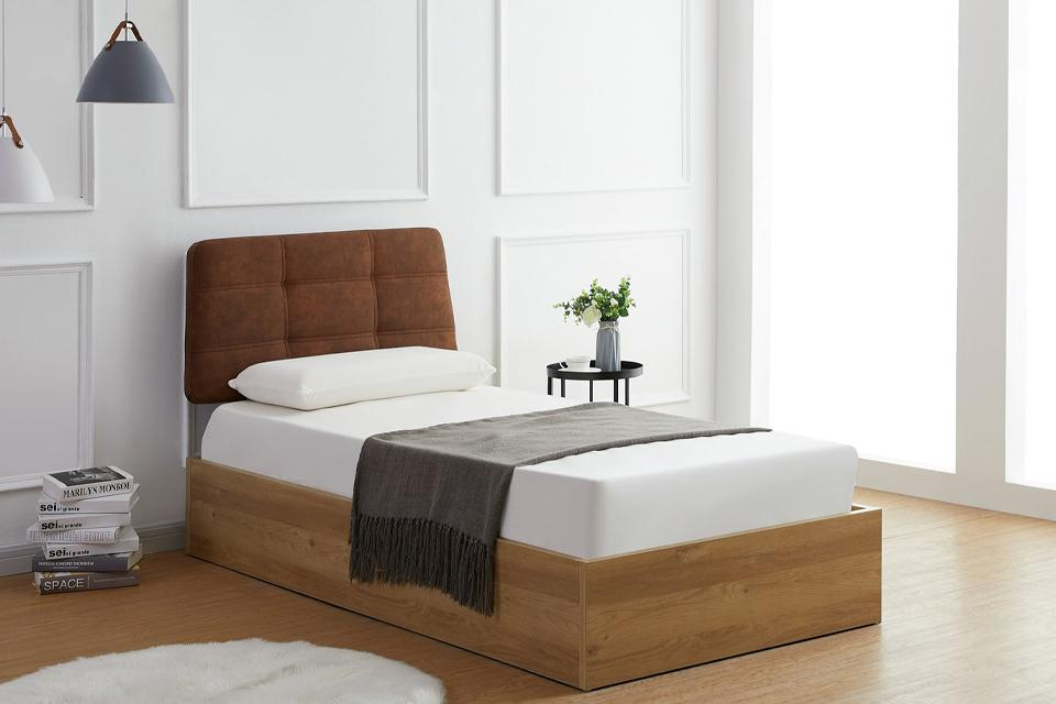 5. Keep it cosy with an upholstered headboard