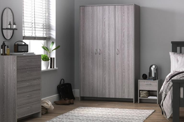 Oak grey wardrobe in modern bedroom interior.