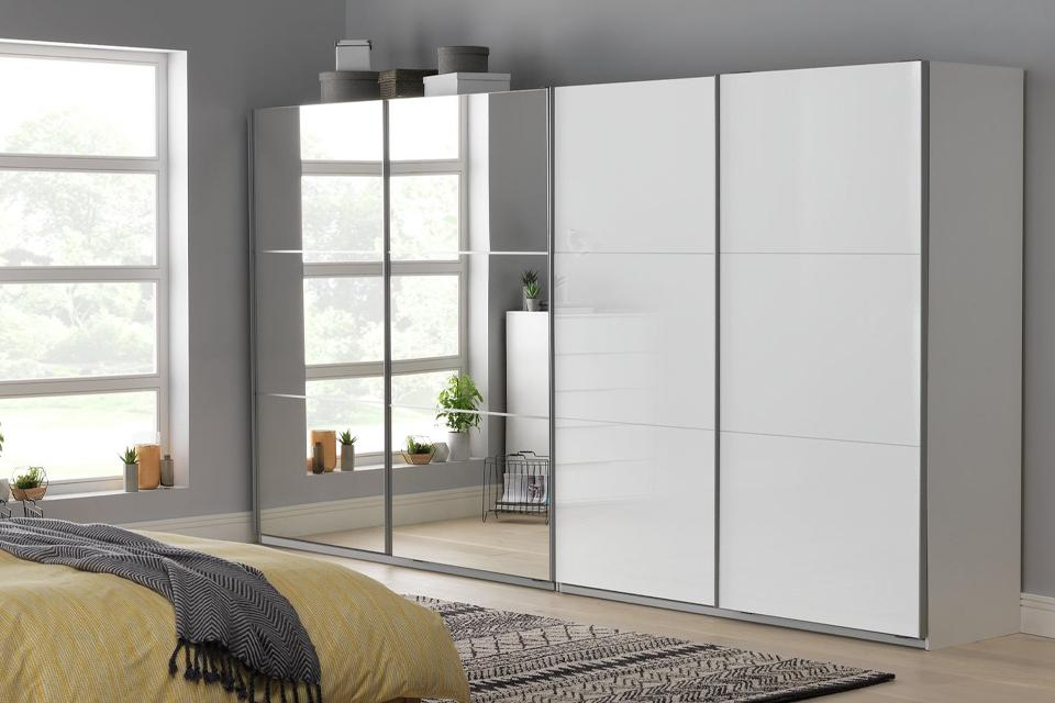 Large wardrobe in bedroom with mirror doors.