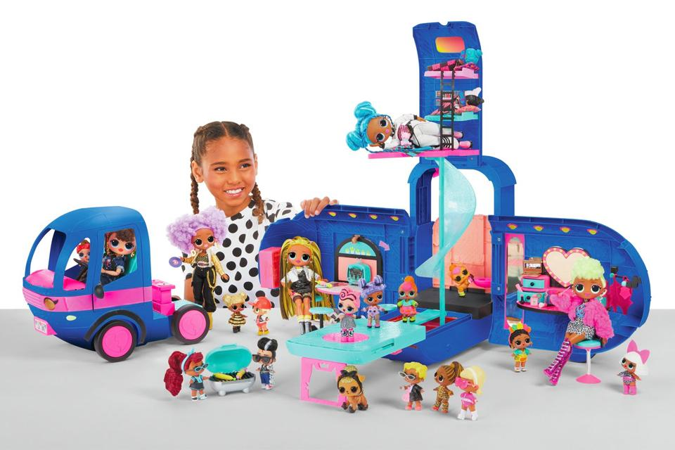 Girl playing with Lol Surprise 4-in-1 Glamper set.