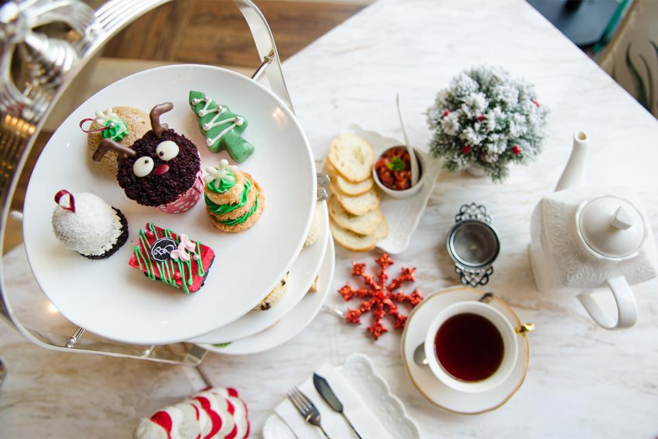 Tea and Christmas themed cakes.
