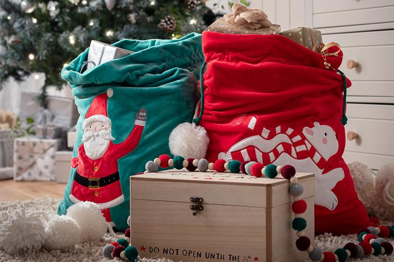 Christmas Eve box and presents next to tree.