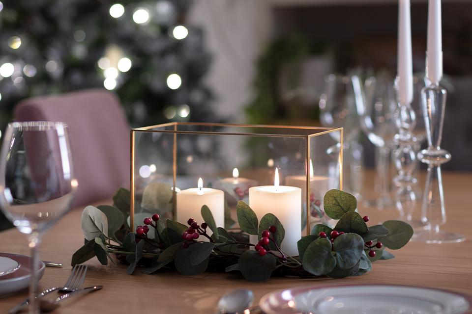 Candle centerpieces on dining table.