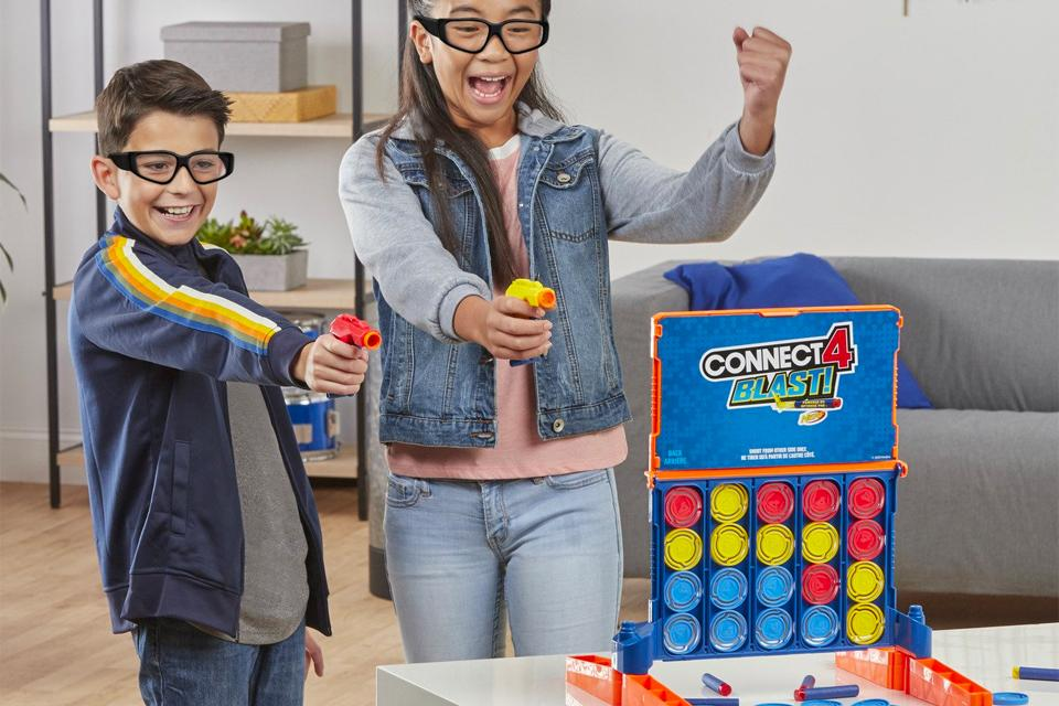 Two children play a Nerf gun edition of Connect 4.