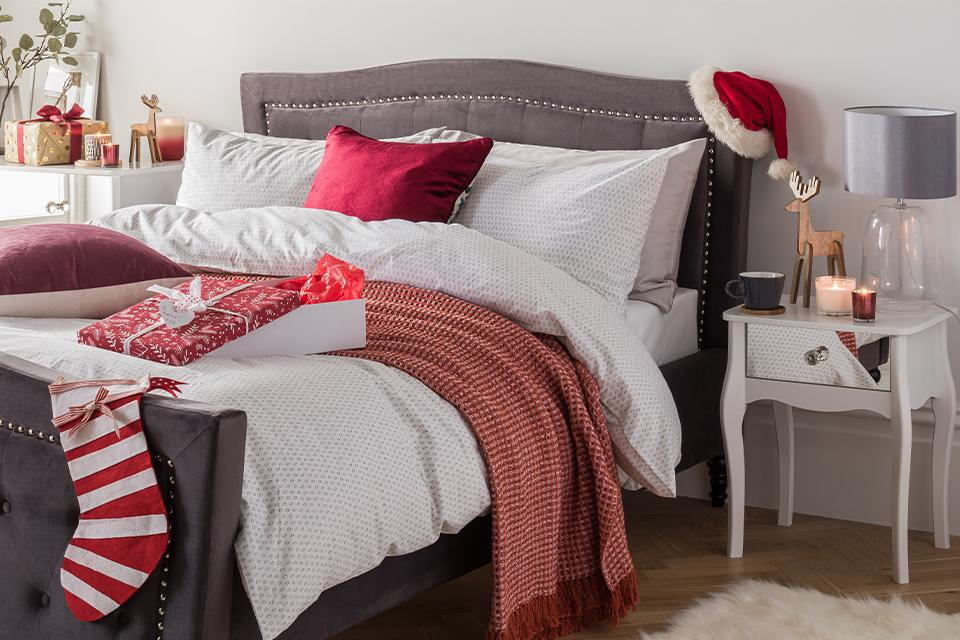 A bedroom set up for Christmas with festive touches.