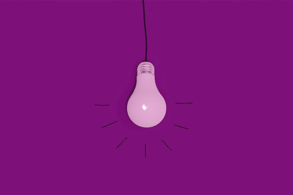 A lightbulb image on a purple background.