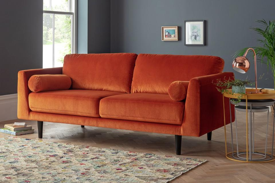 Image of a velvet orange sofa.
