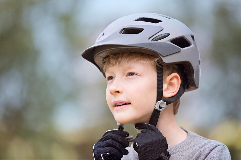 Fitting a child's bike helmet.