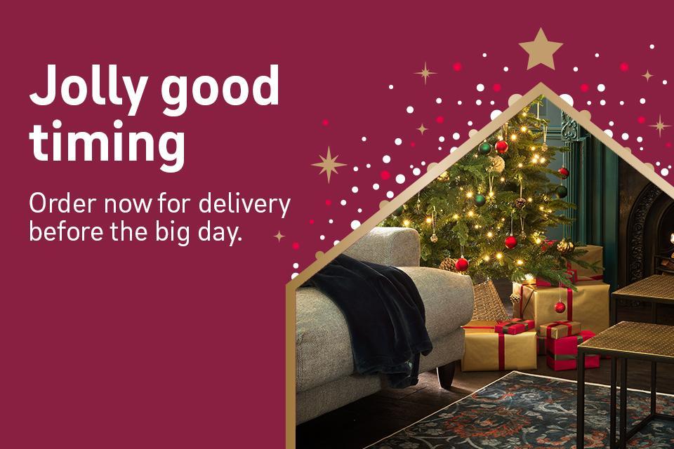Sofa with christmas tree and presents.