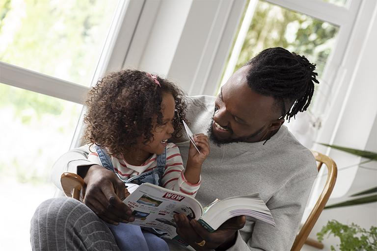 Father and daughter reading.
