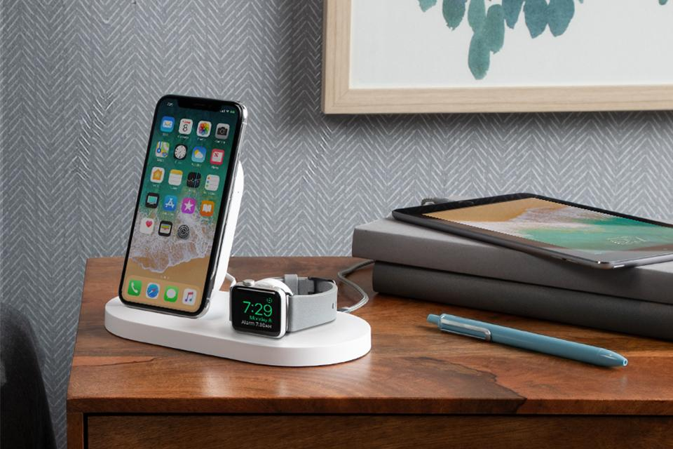 Smart phone and smart watch wirelessly charging on Belkin device.