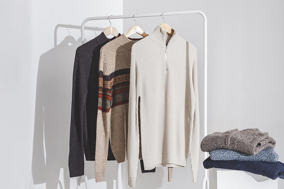 An image of knitted jumpers from TU clothing hanging on a clothes rail.