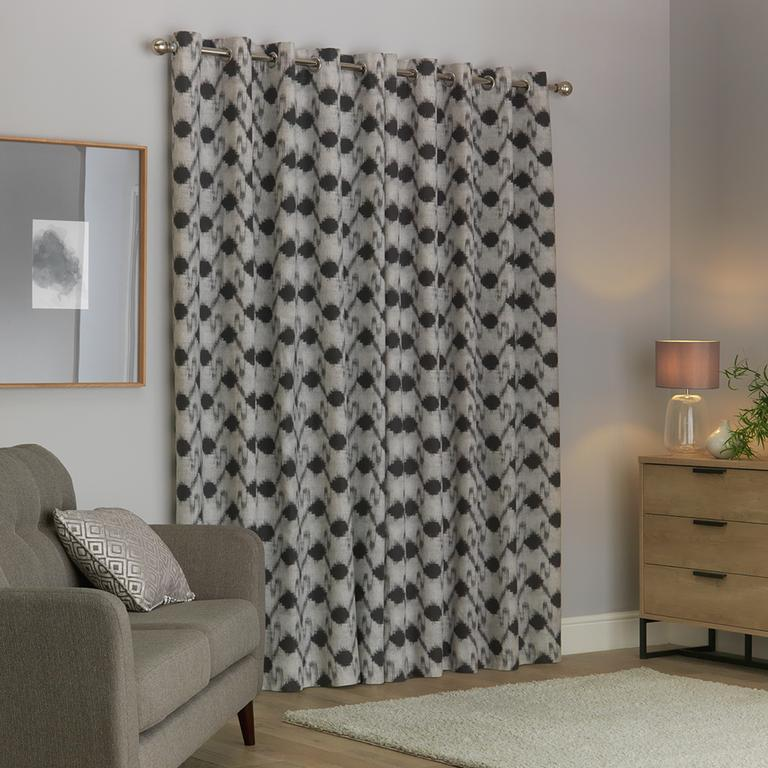Lined curtains block draughts.