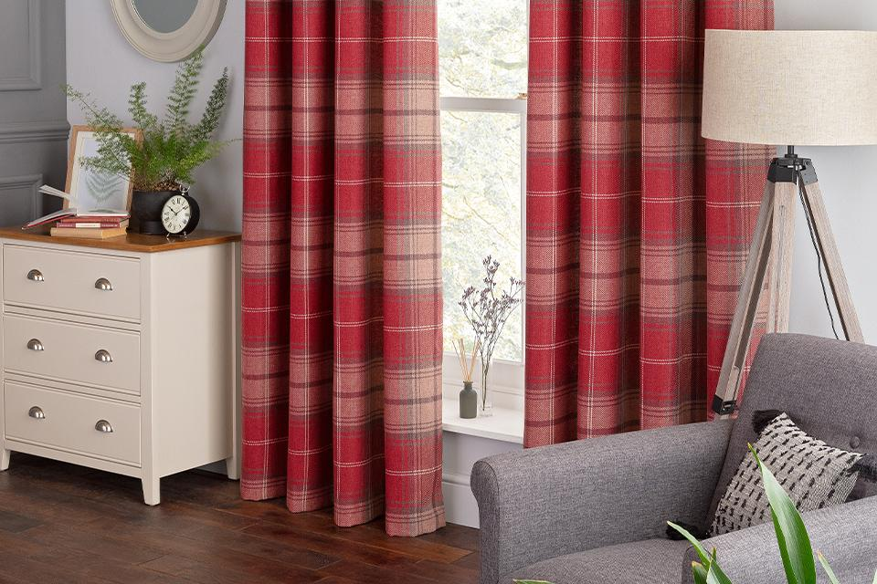 Red checkered curtains in a lounge.