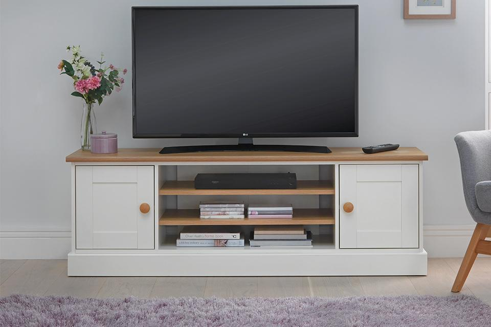 TV on wooden TV stand.