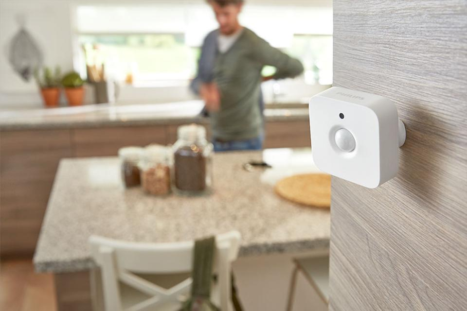 Philips Hue Motion sensor on the wall to automate lights with movement.